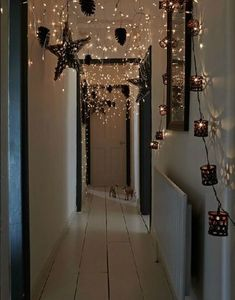 Contemporary Christmas decorations in a scandi home with lots of fairy lights and paper stars Christmas Hallway, Noel Christmas, All Things Christmas, Winter Christmas, Christmas Crafts, Hygge Christmas, Rustic Christmas, Christmas Wreaths, Danish Christmas