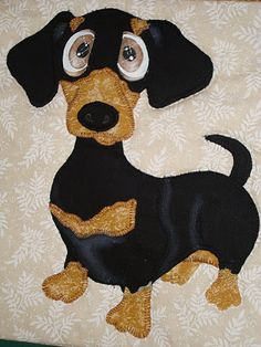Dachshund quilt - cute cute cute!!!  I love the chalk-colored shading that makes his fur look shiny!  This block is so cute it makes me want a Doxie!