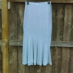 Grey Maxi skirt Grey Maxi skirt with elastic waistband. Brand new took tags off and never wore. Mermaid type style. Lovely and stretchy. Length is 38 inches long. 95% rayon 5%spandex Mossimo Supply Co. Skirts Maxi