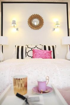 gorg mix of black and white with pops of pink, gold and purple and nice mix of patterns. just the right touch of girly