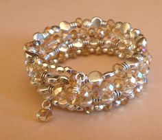 Peachy Queen Crystal Coil Bracelet by McHughCreations on Etsy