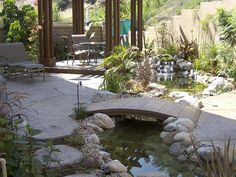 A soothing pond runs through the homeowners backyard allowing plenty of room for the koi fish to swim. A small bridge covers the area where the pond narrow