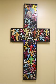 LRCA 6th Grade Collaborative Art Project: 7 foot wooden cross embellished with original individual crosses created by 6th grade students. #wildaboutwarriors