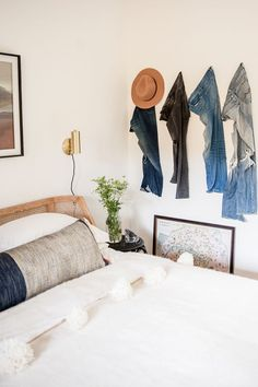 No closets? Hang your denim jeans on the wall like artwork. Small Space Solutions. Ashley Redmond - The Tiny Treehouse - Interior Designer