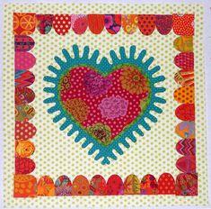 Pretty heart applique block. Pattern is from Kaffe Fassett's <i>Romantic Quilts</i>.