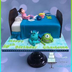 Monsters inc cake including boo, sculley and Mike