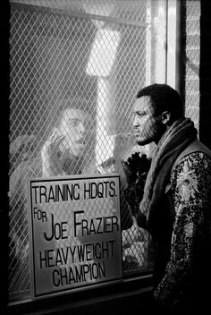 This photograph was taken ahead of the world title fight in 1971. Frazier is steadfastly trying to ignore his bitter rival but in fact you wonder if he's imprisoned by Ali's taunts – a feeling that's reinforced by the wire meshing which separates the two men. I also love how their eyes don't meet; it fills the frame with tension. Photograph: John Shearer/Time & Life Pictures/Getty Image
