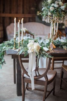 Winter wedding decor - Lush bouquets of garden roses, seeded eucalyptus and olive leaves on vintage chairs {Conforti Photography LLC}