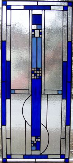 """Custom, stained glass, mission style panel for residence. Designed and built at Stained Glass Express in Waterville, Maine. Measures approximately 18"""" x 40"""". Artist: Lucie Boucher"""