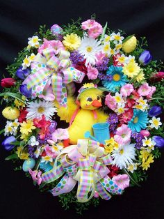 Easter Spring wreath Annalee Duck and Watering Can by UpTownOriginals on Etsy.  Gorgeous wreaths!  http://www.etsy.com/listing/94894736/easter-spring-wreath-annalee-duck-and