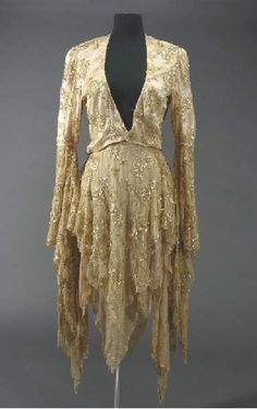 "Stevie Nicks Rhiannon Costume  CIRCA 1970s  A two-piece costume worn by Stevie Nicks during a performance of the song ""Rhiannon,"" written by Nicks about the mythological Welsh goddess Rhiannon - the Goddess of Steeds and the Maker of Birds. The costume consists of a short champagne and gold colored jacket with lace, sequins and applied gold thread with long flowing arms, together with a matching shawl that has a zipper on the left shoulder. #fashion"