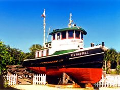 An old tugboat is preserved on the lighthouse grounds. Nautilus Submarine, Tugboats, Tall Ships, Wonderful Places, Lighthouse, Places Ive Been, Florida, Sea, Building