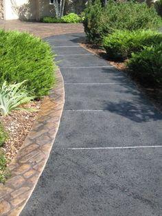 Spray textured concrete overlay on walkway.