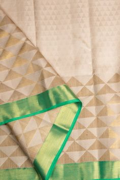 This ivory kanchivaram silk has ghicha work in gold zari. The complementing border and pallu are in spring green with gold zari work making it perfect for a daywear function