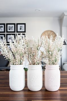 DIY pastel painted mason jar vases. Find this and many other up-cycle projects at 50 DIY Farmhouse Interior Decor Ideas!