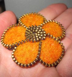 Zipper/Recycled Felted Wool Sweater Tangerine Orange Flower Pin/Brooch. $15.00, via Etsy.