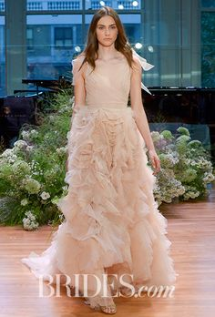 "Brides.com: . ""Ballad,"" dusty rose pleated v-neck high low wedding dress with full embroidered skirt by Monique Lhuillier"