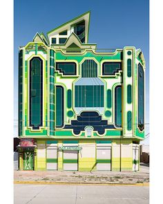 """newyorkermag: """"In a photo portfolio in this week's issue Peter Granser captures the futuristic façades and neon colors of the Bolivian architect Freddy Mamani Silvestre's buildings. We'll be sharing photos from the collection throughout the day. Visit newyorker.com to see more."""""""
