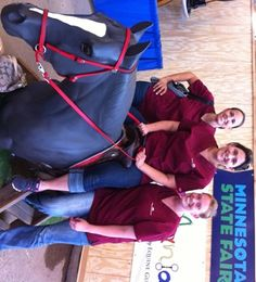 Vet tech students braving the heat to make client education videos at the state fair!