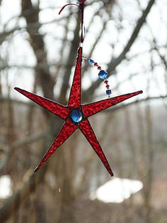Hey, I found this really awesome Etsy listing at https://www.etsy.com/listing/185583950/bright-red-stained-glass-suncatcher-star