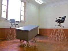 "For his ongoing project titled ""El Directorio"" German artist Thomas Stüssi created a series of sculptural pieces constructed entirely from found office furniture and building materials."