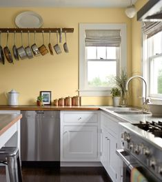 Pale yellow walls, white cabinets, wood counter tops.