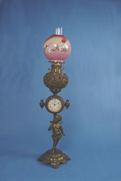 1591: Unusual Gilbert Banquet Lamp Piano Clock : Lot 1591