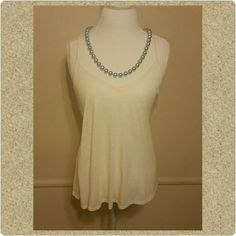 Tank Top Cute tank top with a flowing fit. Match with a pair of shorts and sandals for a day out. Or spice it up with a pair of skinny jeans, heels and a statement necklace and your good for a night out. Like New Condition. Mossimo Tops Tank Tops