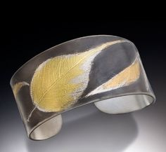 Constance Gildea cuff imprinted with the form of natural leaves