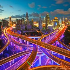 Been there, don't know if I'll go back - Shanghai, China - and YES the highways really do light up like that :)