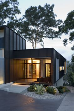 Fig Tree Pocket House Entry emits warm glow at dusk. House Cladding, Facade House, Architecture Details, Modern Architecture, Brisbane Architects, Black House Exterior, Residential Architect, River House, Modern House Design