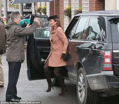 Blossoming: Kates bump was just about visible as she stepped out of the range Rover at the track today. March 15, 2013