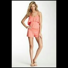 NWOT Tart Romper. Size small. NWOT Beautiful and Soft Jersey Knit Romper from Tart in coral.  Flutter panel at bodice V-back. Ruched panel at waist. Tonal top stitching and panel seaming.  95% Modal and 5% Spandex. Please see pics 2 and 3 for actual romper. Pic 4 shows how it looks from the back. Tart Other