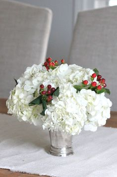 This beautiful centerpiece of ruffly white hydrangea and vibrant red hypericum berries would be lovely for a holiday party or wedding!  Shop hydrangea and hypericum at GrowersBox.com!