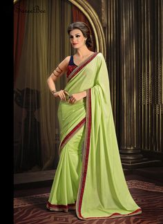 Riveting Embroidered Work Designer Saree  You look so charming wearing this attire. Make the heads flip whenever you costume up in this kind of a attractive green georgette and net designer saree. The fantastic attire creates a dramatic canvas with fantastic embroidered and patch border work. Comes with matching blouse.