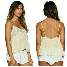 Free People Sweet Lace Cami V-neckline. Fixed shoulder straps. Single button closure at back. Lace trim at hemline. Body: 52% cotton, 48% viscose; Trim: 100% nylon. Machine wash cold, line dry. Imported. From a smoke and pet free home. Comes with extra button. Free People Tops