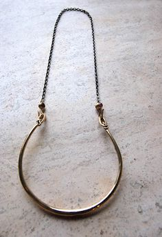 I think this is an earring but I prefer to think of it as a chic grownup swing