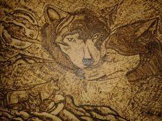 Casal de lobos pirografado em quadro 60x40