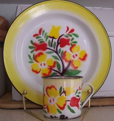 Bright and cheerful vintage floral pattern enamel mug and plate.