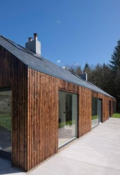 Blakeburn, by Edinburgh-based Architects has gone some way to throwing down the gauntlet in terms of elevating the concept of home renovation. This woodland cottage for a writer in Roxburghshire may appear, on first impressions, to be an exciting . Scottish Cottages, Cottages Scotland, Modern Barn House, Timber House, Bungalows, Cottage Design, House Design, Woodlands Cottage, Casa Patio