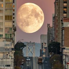 Supermoon rising over California Street in San Francisco by Tony Cheng - San Francisco Feelings