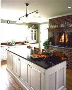Connor Homes - The Emmaline Gabrielle Farmhouse, kitchen. What a kitchen! Farmhouse Fireplace Screens, Fireplace In Kitchen, Brick Fireplace, Fireplace Design, Brick Wall, Fireplace Windows, Craftsman Fireplace, Fireplace Garden, Fireplace Outdoor