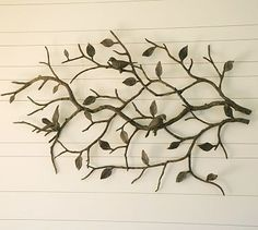Pottery Barn Metal Wall Art.  $449  I have this on my living room wall and it looks amazing.