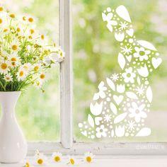 #raamtekening ontwerp, geïnspireerd door papercutting. Een silhouette van een konijn bestaande uit verschillende Lente en Pasen vormen zoals bloemetjes, blaadjes en meer.