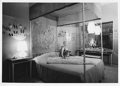 Peggy Guggenheim in her early 60's in the bedroom of Palazzo Venier dei Leoni; behind her Alexander Calder'sSilver Behead(1945-46 PGC) in Venice.