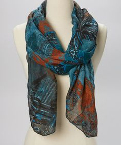 A loop or two of this bold scarf makes accessorizing a breeze. Chic hues, a lightweight design and a modern print combine to create a dramatic play of texture and style.