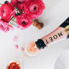 Let's pour a glass of champagne....it's been a long day and we deserve it  #champagne #flowers #pink #moet #peonies