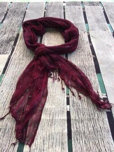 The Burgundy Babe summer scarf brings together a blend of rich burgundy, purple and soft muted pink along with a subtle smattering of a leaf and floral print
