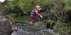 A boy takes a leap of faith into the water while canyoning in North Glen Sannox on the Isle of Arran