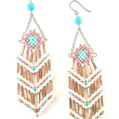 These intricately-made earrings were designed by the sister and brother team TSOul. Drawing on their heritage and the colors of the Southwest, the Navajo duo creates cool beaded jewelry in various forms.